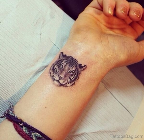 Tiger Face Tattoo On Wrist