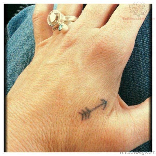 Tiny Arrow Tattoo On Hand