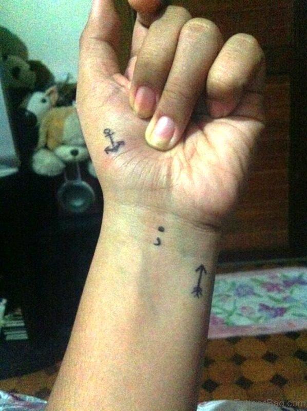 Tiny Arrow Tattoo
