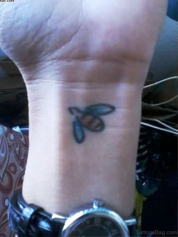 Tiny Bee Tattoo On Wrist