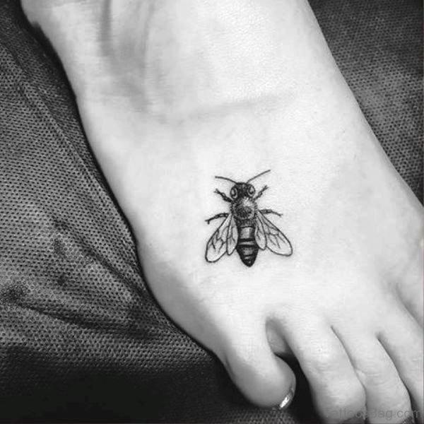Tiny Black Bee Tattoo On Foot