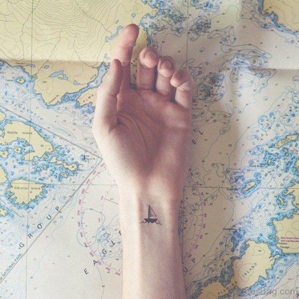 Tiny Boat Tattoo On Wrist