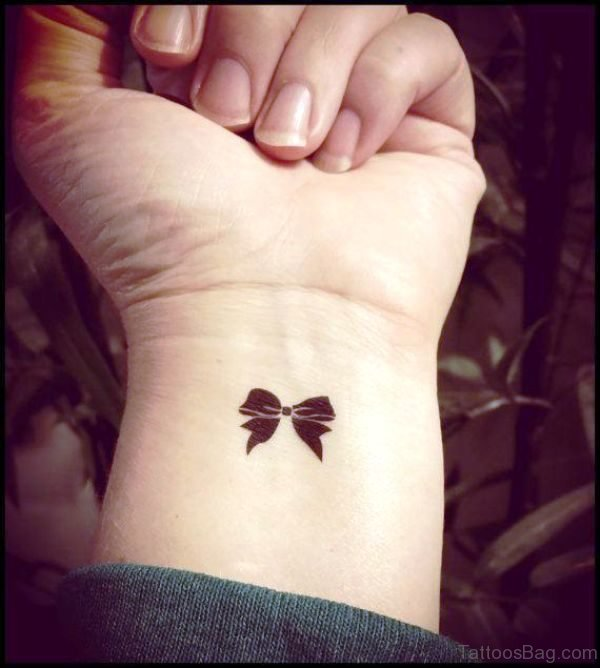 Tiny Bow Tattoo On Wrist