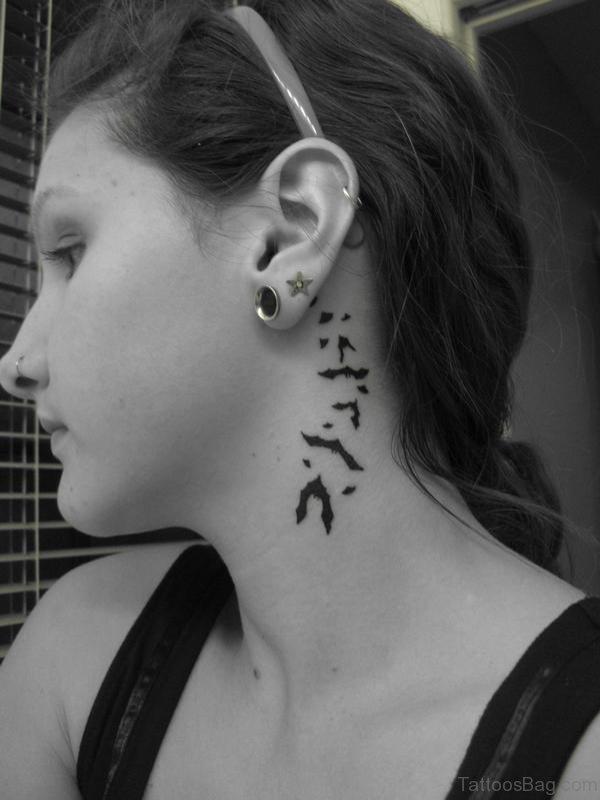 Tiny Flying Bats Tattoo On Neck