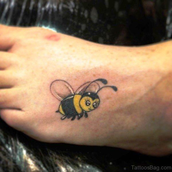 Tiny Yellow Bee Tattoo On Foot