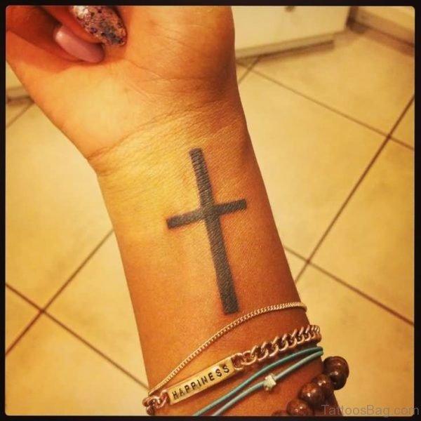 Tremendous Cross Tattoo On Wrist