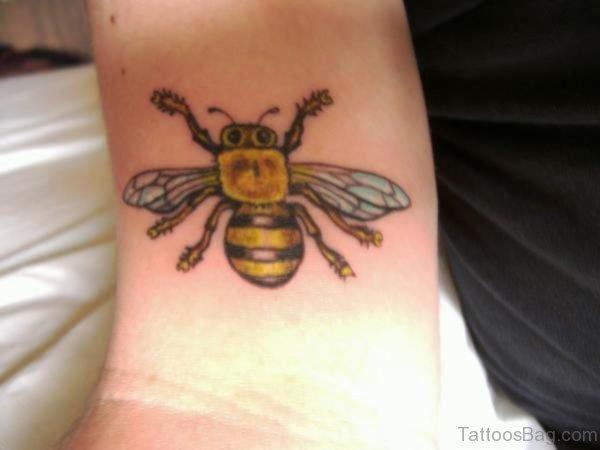 Tremendous Yellow Bee Tattoo On Wrist