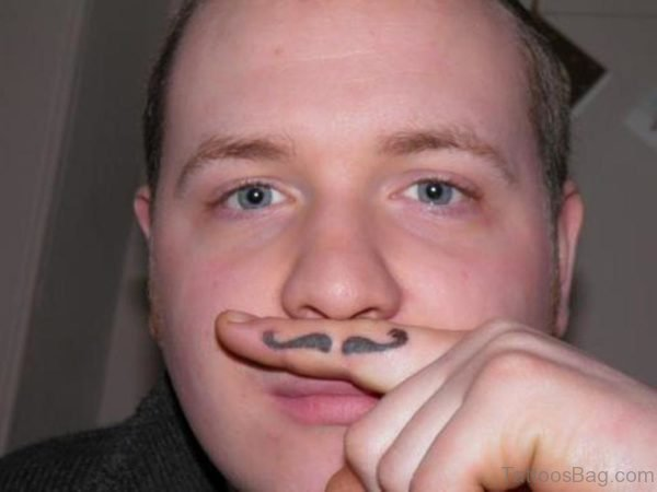Trendy Mustache Tattoo On Finger