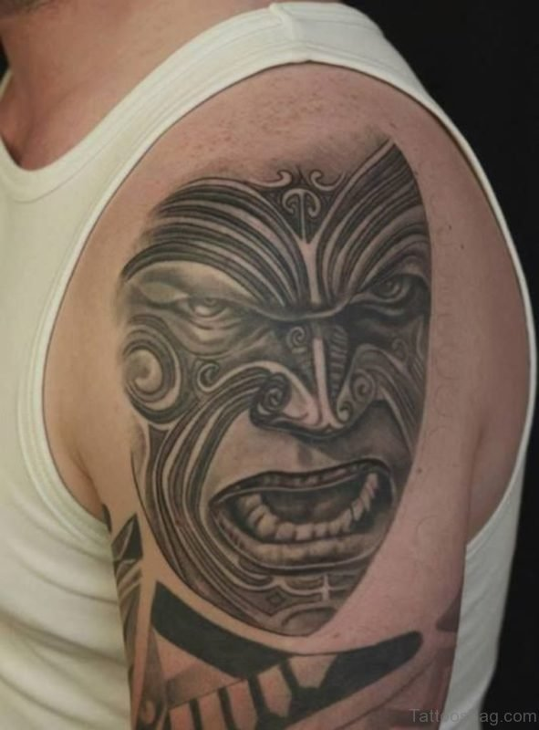 Tribal Black And Grey Mask Tattoo On Shoulder