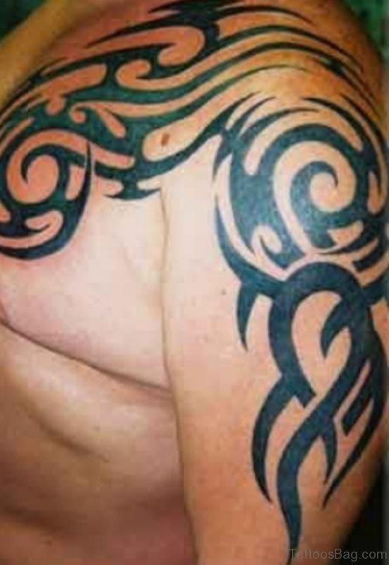 Tribal Dragon Shoulder Tattoo