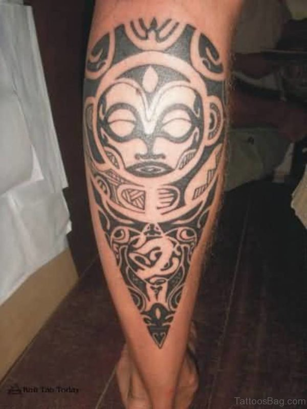 Tribal Mask Tattoo On Lower Leg