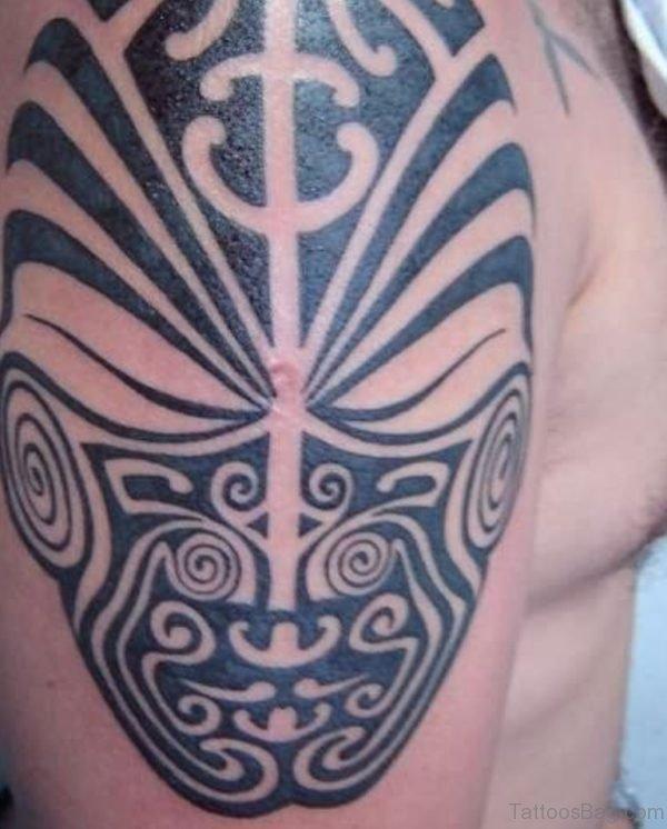 Tribal Mask Tattoo On Shoulder