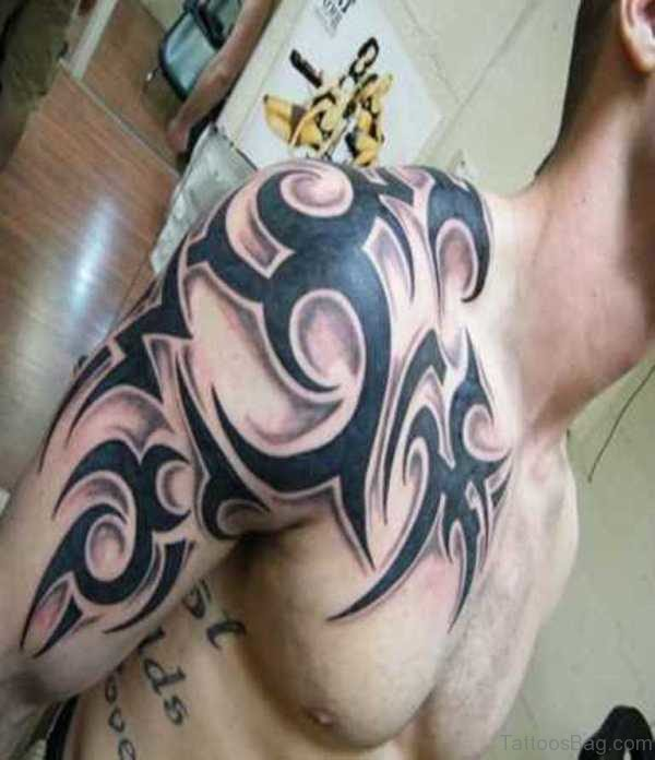 Tribal Tattoo On Right Front Shoulder