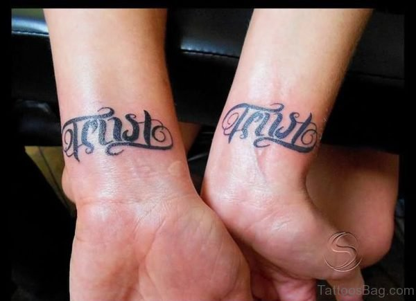 Trust Ambigram Tattoo On Wrist For Couple