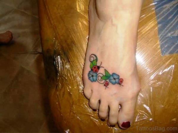 Unique Ladybug Tattoo On Flowers
