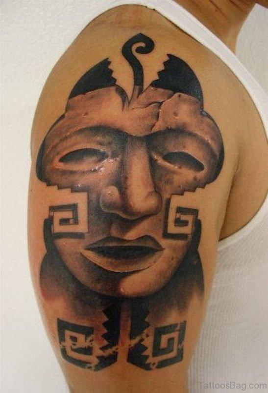 Unique Mask Tattoo On Shoulder