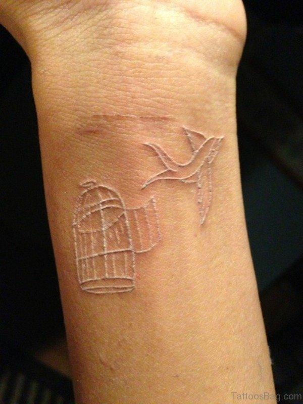 Black bird tattoo on wrist