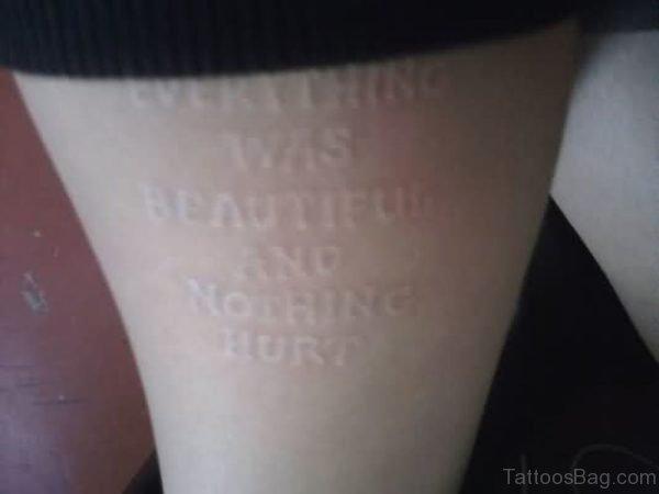 White Ink Wording Tattoo On Thigh