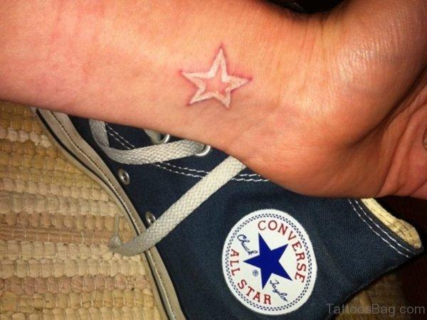 White Star Tattoo On Wrist
