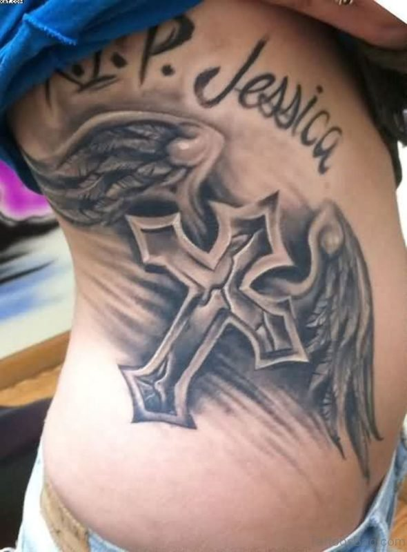 Winged Cross Tattoo For Women On Rib Side