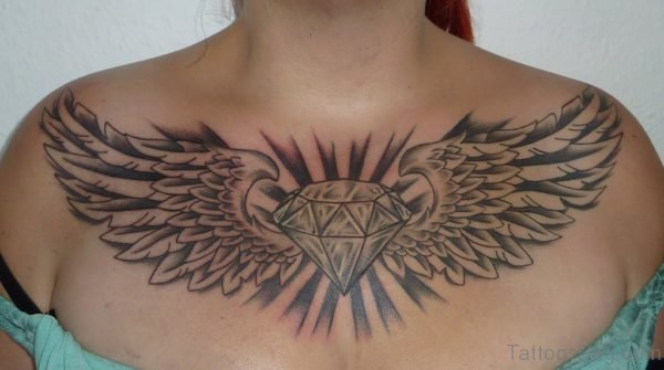 Wings And Diamond Tattoo On Chest