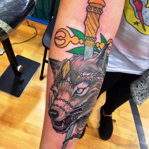 Wolf And Dagger Tattoo On Arm