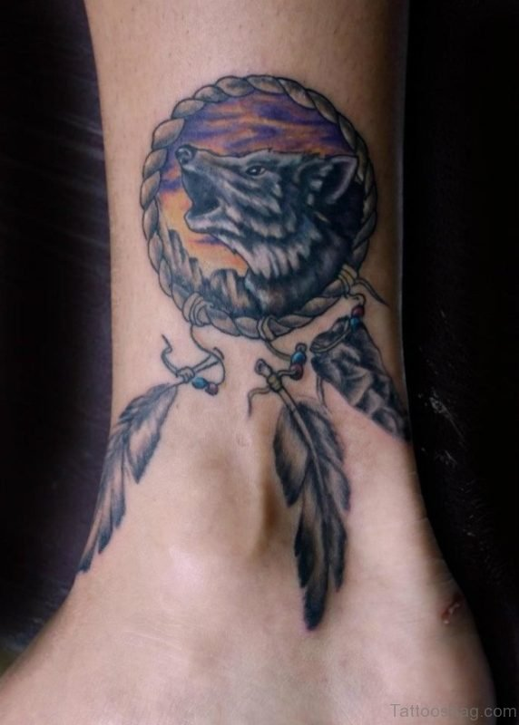Wolf And Dreamcatcher Tattoo On Ankle