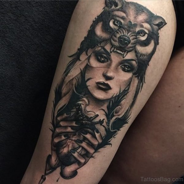 Wolf And Girl Face Tattoo On Thigh