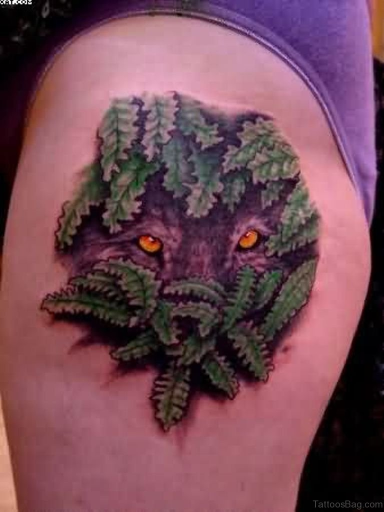 70 great looking wolf tattoos on thigh for Wolf eyes tattoo designs