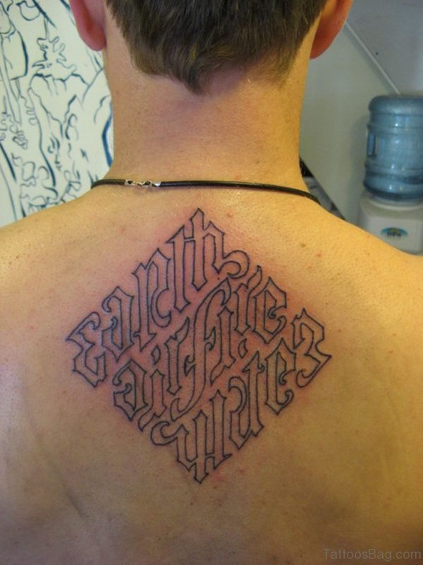 Wonderful Ambigram Tattoo On Upper Back