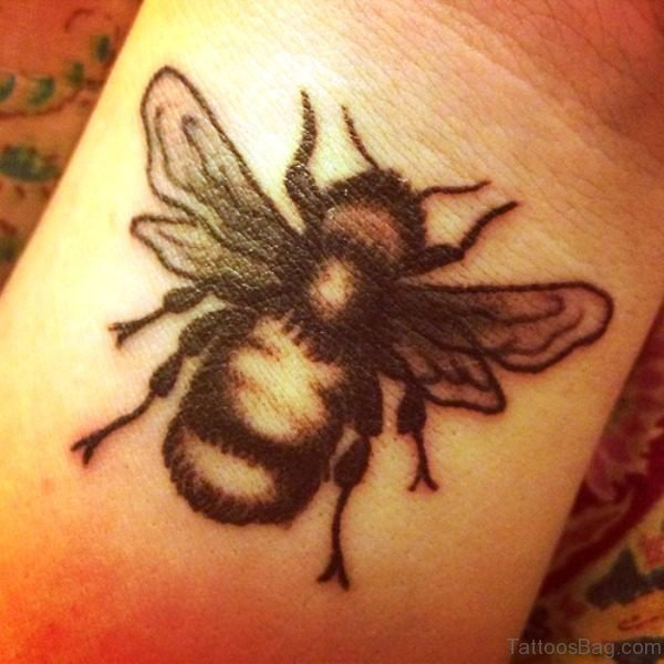 Wonderful Black Bee Tattoo On Wrist