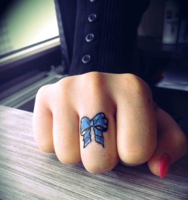Wonderful Blue Bow Tattoo On Middle Finger