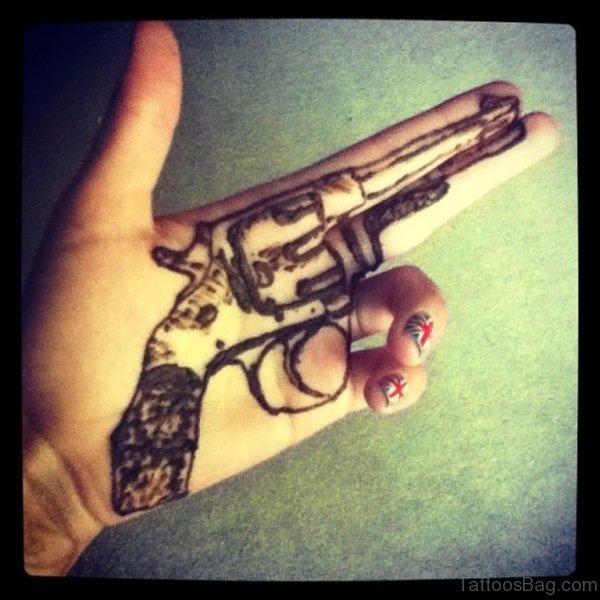 58da6706149d7 22 Wonderful Gun Tattoos On Finger