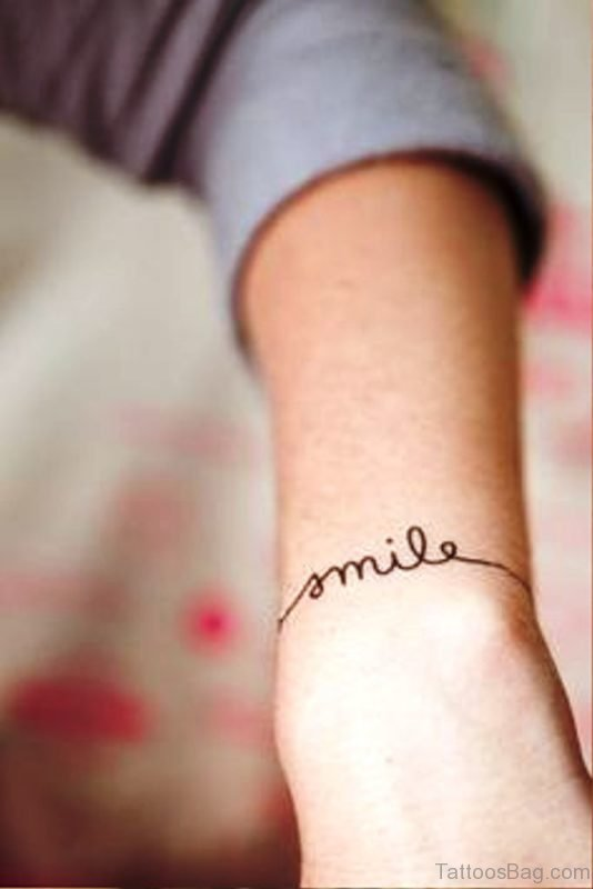 Wonderful Smile Tattoo On Wrist