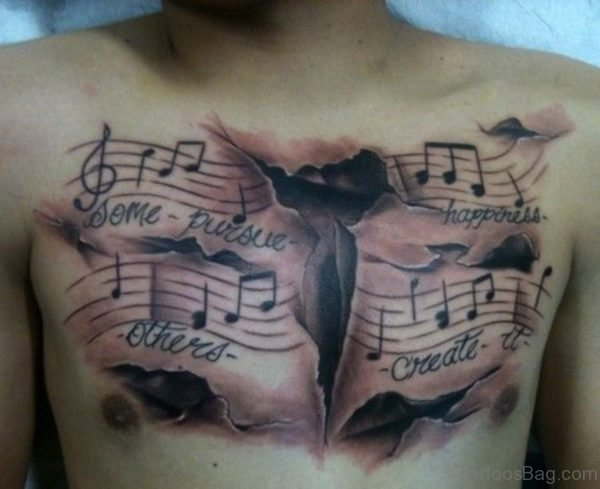 Word And Musical Tattoo On Chest