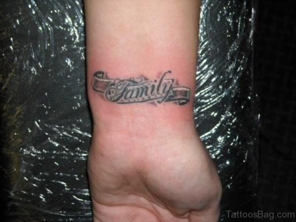 Word Family Banner Tattoo On Wrist