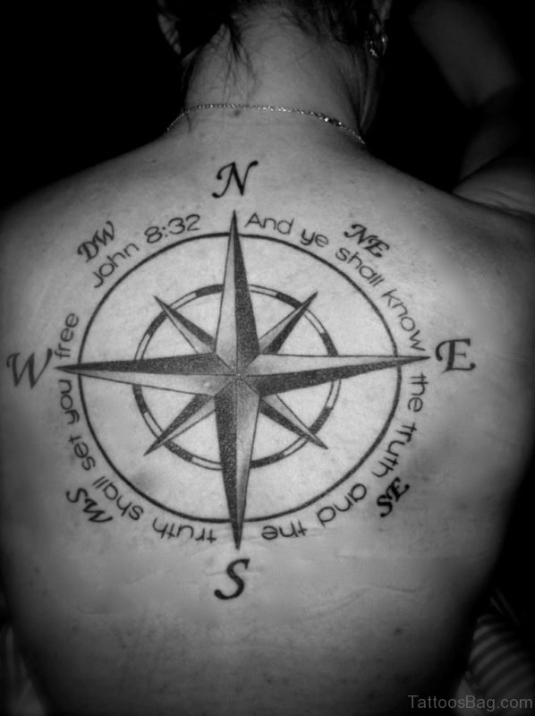 Wording And Compass Tattoo On Back