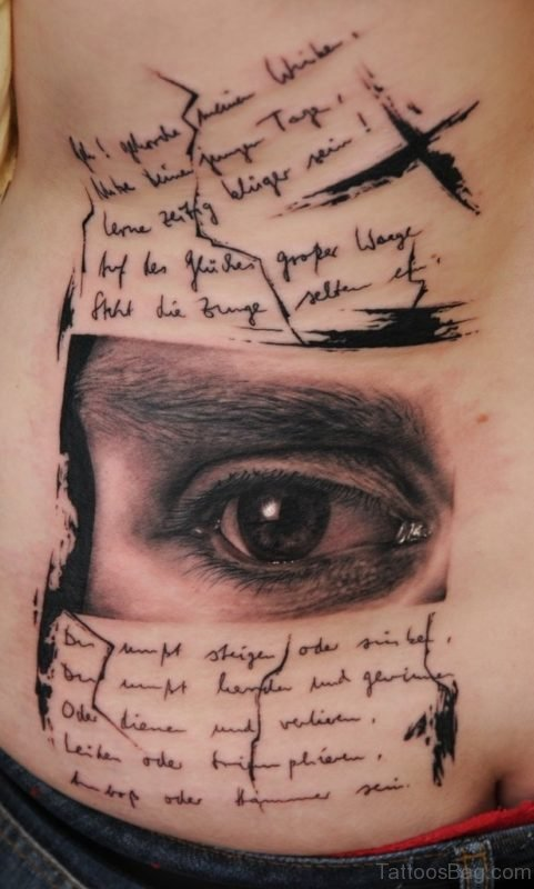 Wording And Eye Tattoo On Rib