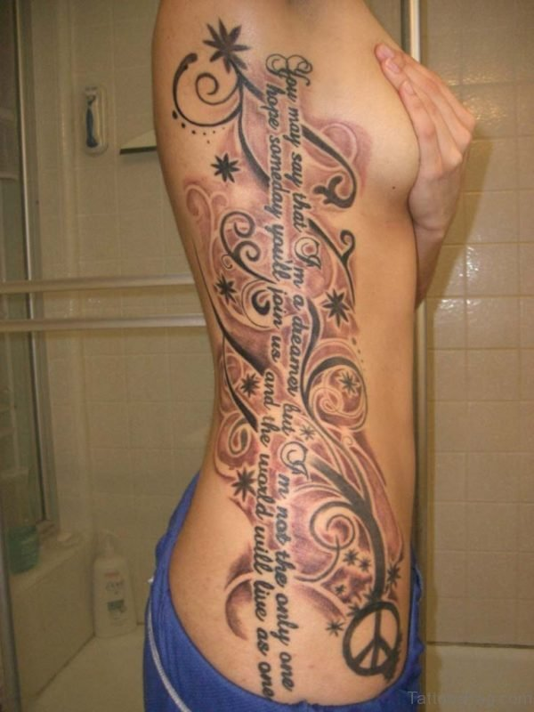 Wording And Tribal Tattoo On Rib