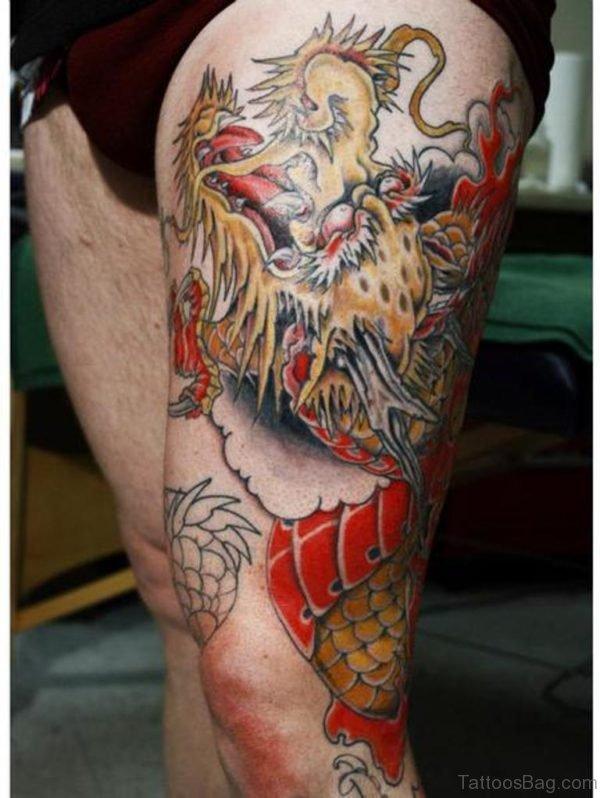 Yellow Dragon Tattoo On Thigh