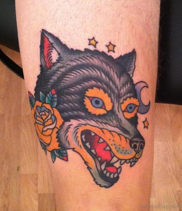 Yellow Rose Flowers And Wolf Head Tattoo On Leg