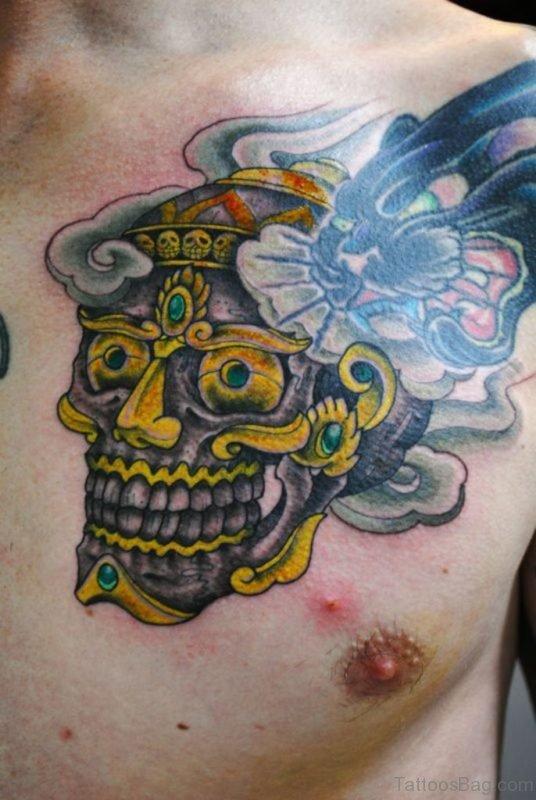 Yellow Skull Tattoo On Chest