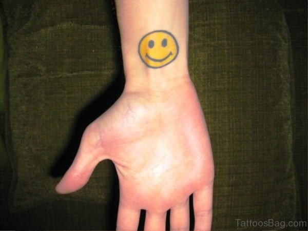 Yellow Smiley Tattoo On Wrist
