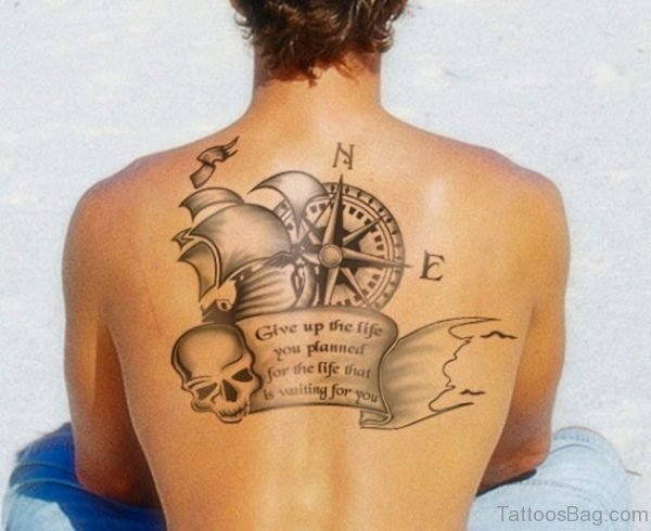 Compass tattoo with ship skull on upper back