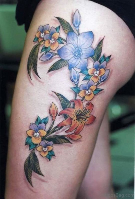Lovely Flowers Tattoo On Thigh