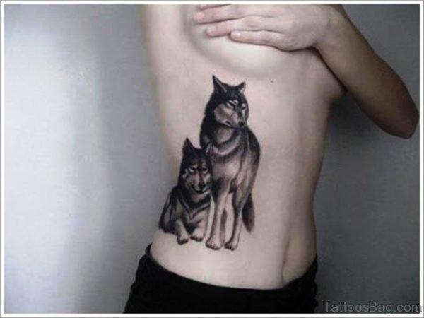 2 Alpha Wolves Tattoo Design On Rib
