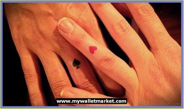 Aces Tattoo On Finger