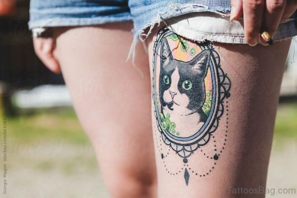 Adorable Cat Tattoo On Thigh