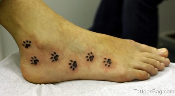 Adorable Paw Print Tattoo On Foot