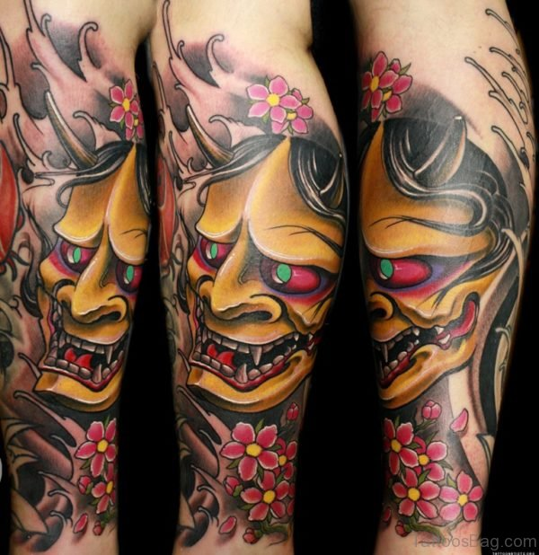 African Mask Tattoo On Leg